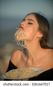 Hunger, appetite, recipe. Chef woman with red lips eat pasta. Woman eating pasta as taster or restaurant critic. Italian macaroni or spaghetti for dinner, cook. Diet and healthy organic food, italy.