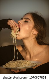 Hunger, appetite, recipe. Chef woman with red lips eat pasta. Diet and healthy organic food, italy. Woman eating pasta as taster or restaurant critic. Italian macaroni or spaghetti for dinner, cook.