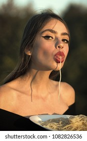 Hunger, appetite, recipe. Chef woman with red lips eat pasta. Italian macaroni or spaghetti for dinner, cook. Woman eating pasta as taster or restaurant critic. Diet and healthy organic food, italy.