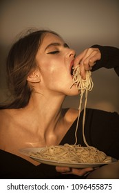 Hunger, appetite, recipe. Chef woman with red lips eat pasta. Diet and healthy organic food, italy. Woman eating pasta as taster or restaurant critic. Italian macaroni or spaghetti for dinner, cook