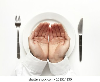 Hunger concept. Man holding hands for food isolated on white from top view.