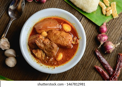 """""""Hunglei Curry, Kaeng hang le"""" is popular red curry in Northern region of Thailand originates from Myanmar. A curry include pork, shallot, dried chillies, salt, garlic, spice masala mix, belly pork."""