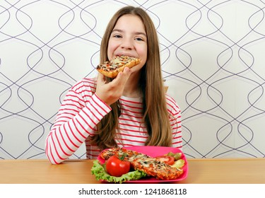 hungry beautiful teenage girl eats sandwich