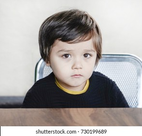 Hungry boy with sad face waiting for food, Unhappy kid concept