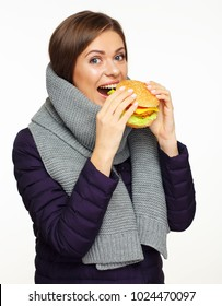 hungry girl bite fast food burger. isolated portrait on white.