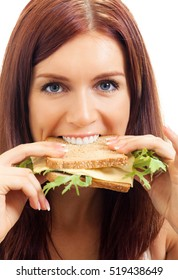 Hungry gluttonous woman eating sandwich with cheese, isolated on white background. Healthy eating and vegetarian dieting concept studio shot.