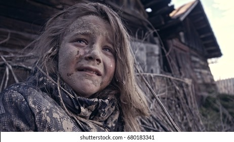 A hungry homeless child cries. War.