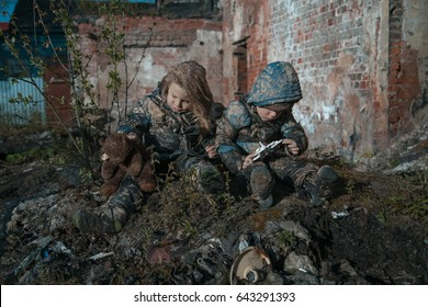 Hungry homeless children near the ruins.