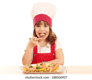 hungry little girl cook eat salmon seafood