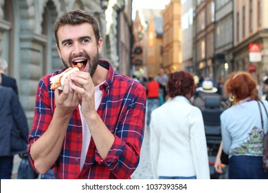 Hungry male devouring a hot dog