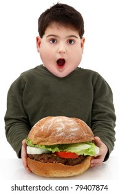 Hungry obese fat boy child with giant hamburger over white.