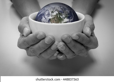 Hungry people and the earth in white ceramic bowl. Conceptual saving earth, saving environment, earth care, people care, help and share, starvation and hungry people.