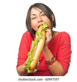 Hungry pretty girl eats a sandwich