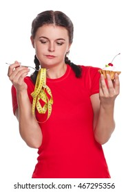 Hungry young girl with cake and tape measure isolated on white background