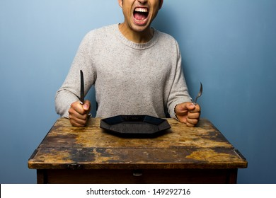 Hungry young man is screaming for his dinner