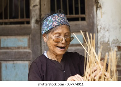 Hungyen, Vietnam - July 26, 2015:Unidentified woman was weaving bamboo in HungYen, Vietnam. Weaving this tools that used to catch fish is traditional occupation in Hung Yen province.
