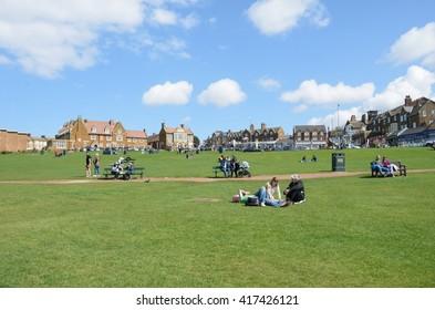 HUNSTANTON  NORFOLK  UK 17 April  2016: People on the Green at Hunstanton North Norfolk enjoying the sun