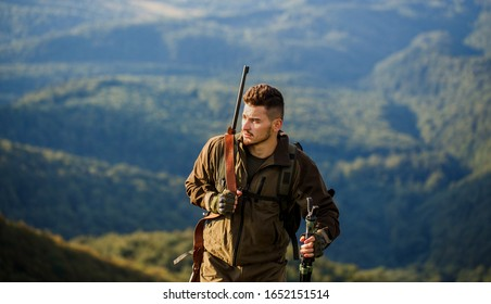 Hunt hunting rifle. Hunter man. Hunting period. Male with a gun. Hunter with hunting gun and hunting form to hunt. Shooter sighting in the target. The man is on the hunt.