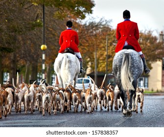 Hunt master & hounds in the street