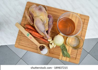 A hunted pheasant being prepared for marination