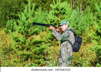 Hunter aiming at his prey standing