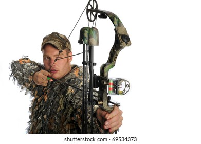 Hunter aims a compound bow and arrow