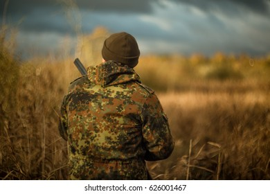 Hunter in camouflage jacket on hunting in anticipation of prey