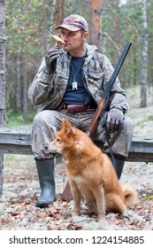 hunter with dog finnish spitz during the rest