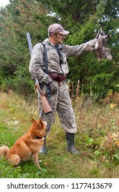 hunter and dog with hunting trophy-black grouse