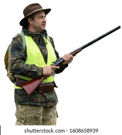 A hunter in a hat in a reflective green vest with a gun stands on an isolated white background.