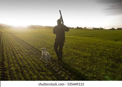 Hunter with hunting dog and rifle