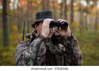 Hunter looking into binoculars
