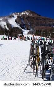 Hunter, NY, USA February 17, 2013 Skis rest on a rack at the bottom of a slope at a ski resort in Hunter, New York