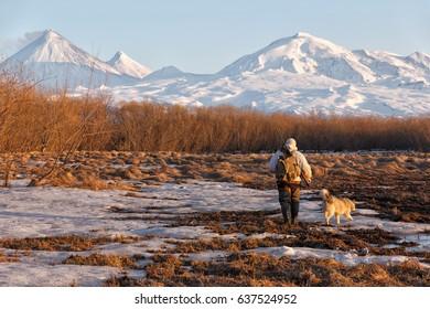 The hunter on Kamchatka. Russia.  Kluchevskaya group of volcanoes.The volcano of Klyuchevskaya sopka. (4800 m) is the highest active volcano of Eurasia.