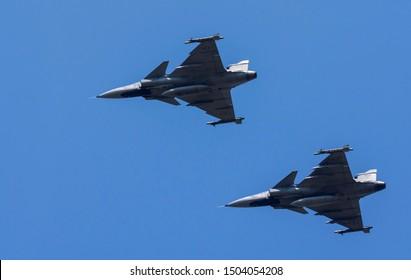 hunter plane flying in the blue sky