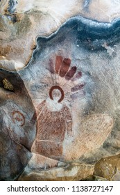 Hunter River, Western Australia, Australia  - July 24 2017: Wandjina are creator spirits from the Dreamtime. Tradition holds that these marks were made in the rock when they passed to the spirit world