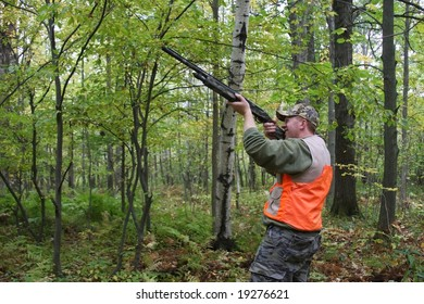 hunter with shotgun in the forest