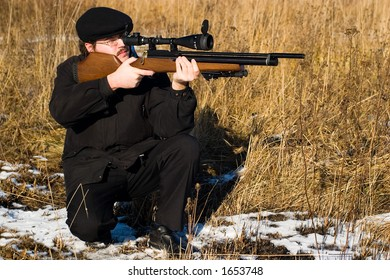 Hunter or sniper aiming to his victim