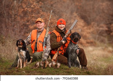 hunters with dogs hunting a bird woodcock