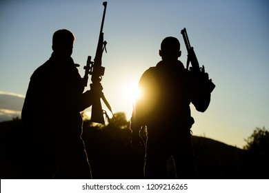 Hunters friends gamekeepers with guns silhouette sky background. Hunters rifles nature environment. Hunter friend enjoy leisure. Hunting with partner provide greater measure safety fun and rewarding.