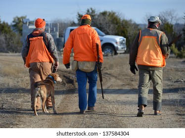hunters with a guide in the field