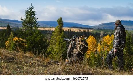 Hunters on a Mountain Ridge