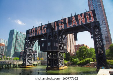 HUNTERS POINT, NY - SEPT 19:  Historic steel railroad gantries at  Hunters Point, Long Island City, NY on Sept 19, 2013. These landmarks were once used to load and unload rail car floats and barges.