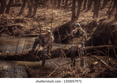 Hunters resting in forest during hunting season