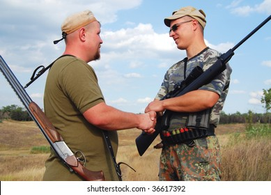 hunters shakes hands mutually