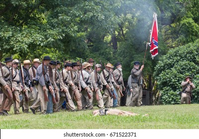 HUNTERSVILLE, NC - July 1, 2017:  Military reenactors in Confederate uniforms recreate the American Civil War Battle of Gettysburg at Historic Latta Plantation on the 154th anniversary of the battle.