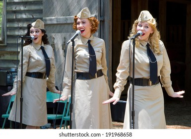 HUNTERSVILLE, NC - MAY 3, 2014:  Three female American singers performing at Historic Latta Plantation as part of a World War II reenactment in commemoration of the 70th anniversary of D-Day.