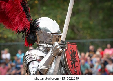 Huntersville,North Carolina / USA - October 06 2019 : Man wears knight armor and takes up his lance in Knight Jousting Show in The Carolina Renaissance Festival.