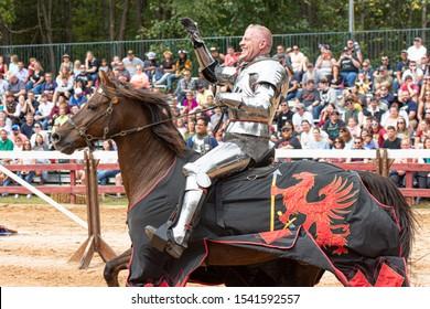 Huntersville,North Carolina / USA - October 06 2019 : Man wears knight armor and performs Knight Jousting Show in The Carolina Renaissance Festival.