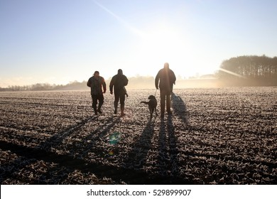 Hunting crew heading out to hunt, early november morning in Denmark.